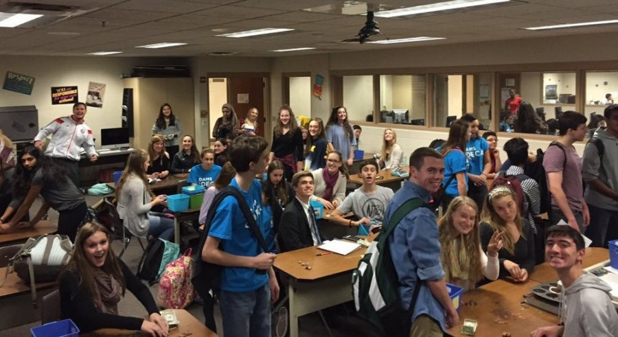 Adams DECA counting their $4,160 raised last year from the Miracle Minute fundraiser.