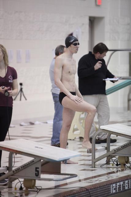 Junior Graham Miotke prepares to swim for the rigorous event ahead of him.