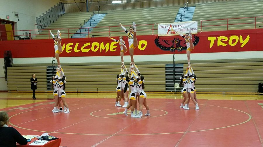 The+Adams+Girls+Varsity+Cheer+team+performs+stunts+at+a+recent+competition.