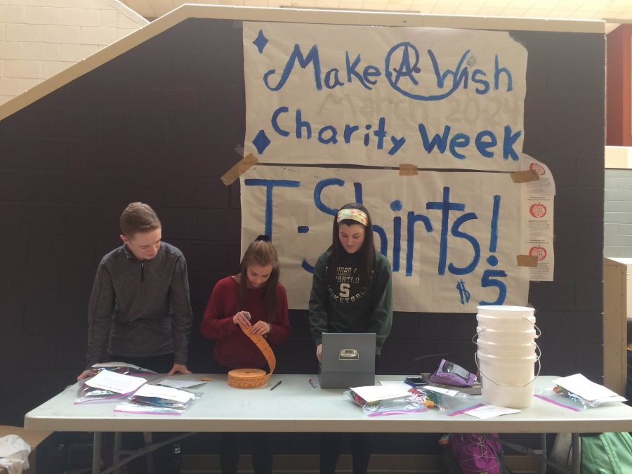 Student Council members sell this years tie-dye Charity Week shirts.
