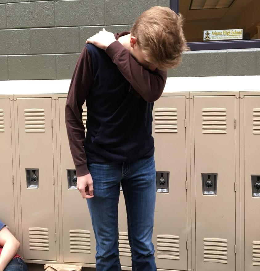 Senior Forest Mason suffers through his cold at school to avoid the absences.