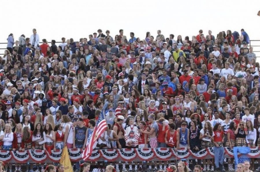 The+Adams+Student+Section+right+before+the+annual+crosstown+rivalry+football+game+against+Rochester+High+School.