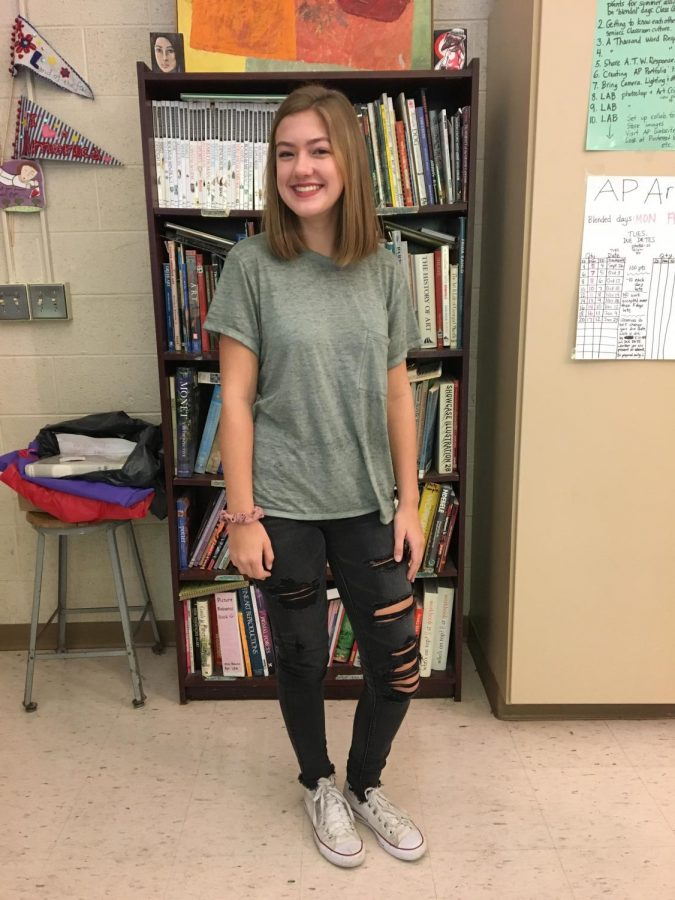 Junior Caitlin Martens dresses up in cuffed jeans and accessorizes with an adorable scrunchie.