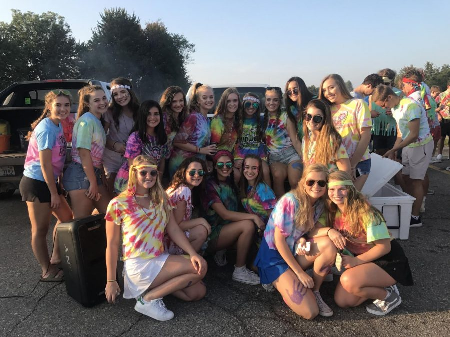 Junior girls sport their hippie gear while tailgating at an Adams football game on September 22.