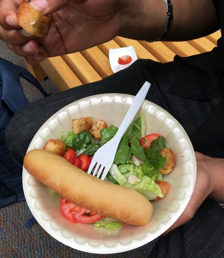 Crusty bread stick with limp salad.