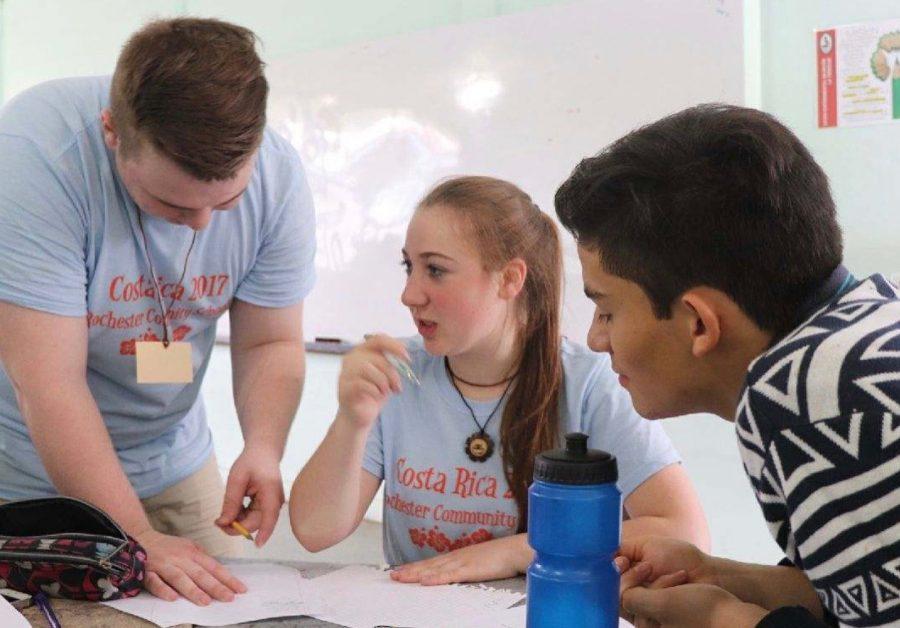 Amanda Kommor and Zach Pfannes in Costa Rica helping Daniel Vargas study for his big math exam.