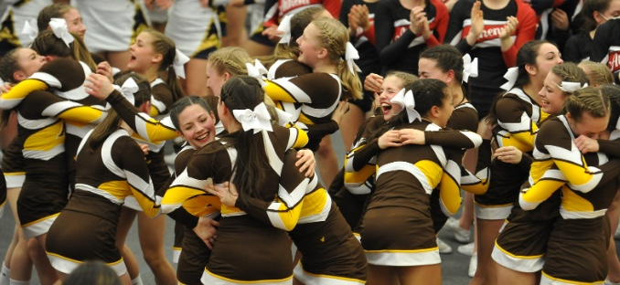 The Adams Varsity Cheer Team celebrates their District Title after results are announced.