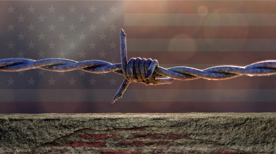 Metal wiring of a border fence tied up in a knot-symbolic of the intense debate in America.