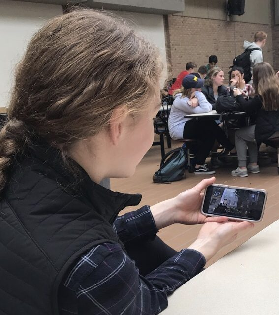 Junior Claire Sanford binge-watches Stranger Things at lunch in the Adams Cafeteria.