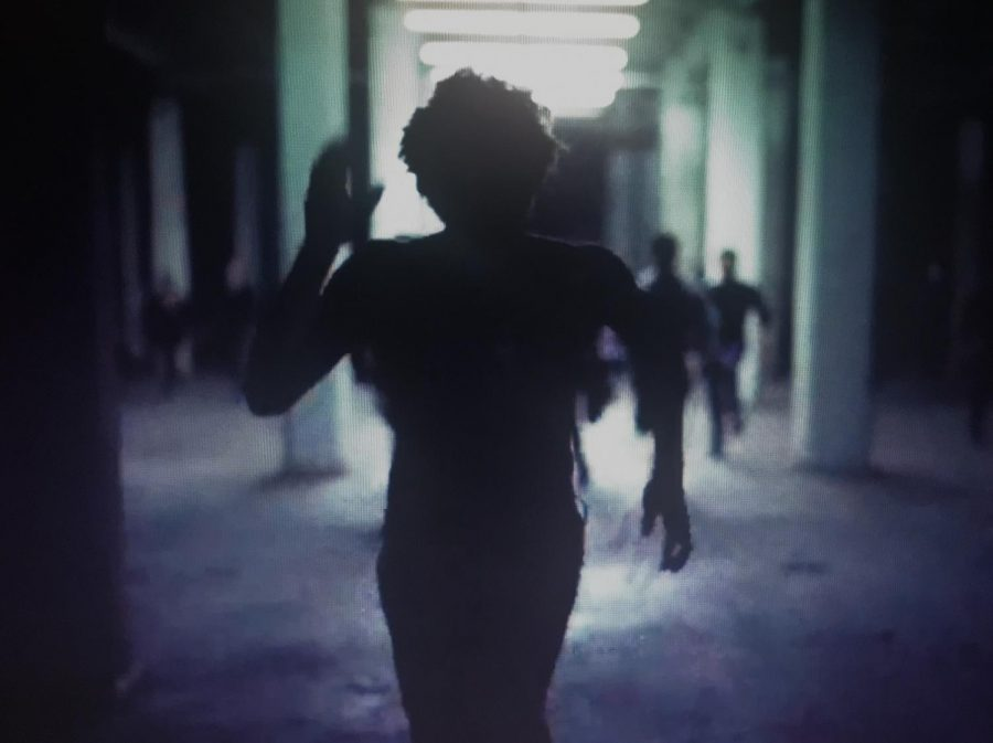 Gambino runs from the police as he embodies an African American facing unreasonable treatment and punishment.