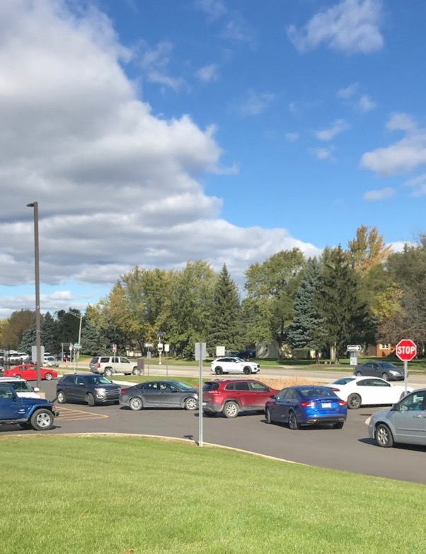 Traffic lining up prior to school being let out.