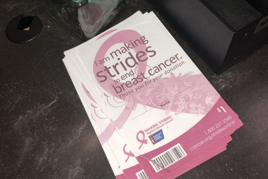 Starbucks handed out flyers for breast cancer awareness to customers.