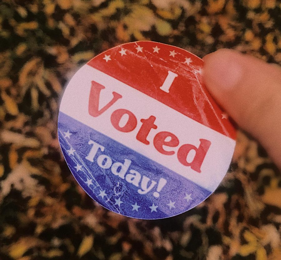 Midterm+Election+voters+receive+a+sticker+to+wear+and+encourage+others+to+go+out+and+vote+as+well.