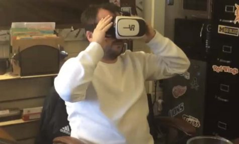 Social Studies Teacher, Josh Hickey watching a VR horror themed video.