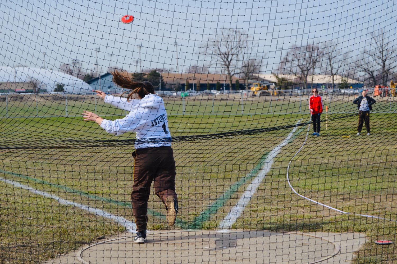 Grace throwing discus at the Royal Oak relays in May of 2018.