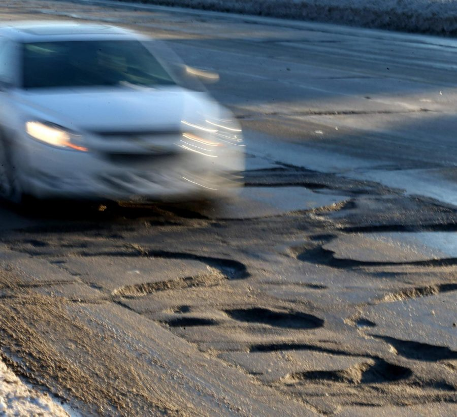A main road in Michigan littered with dangerous potholes.