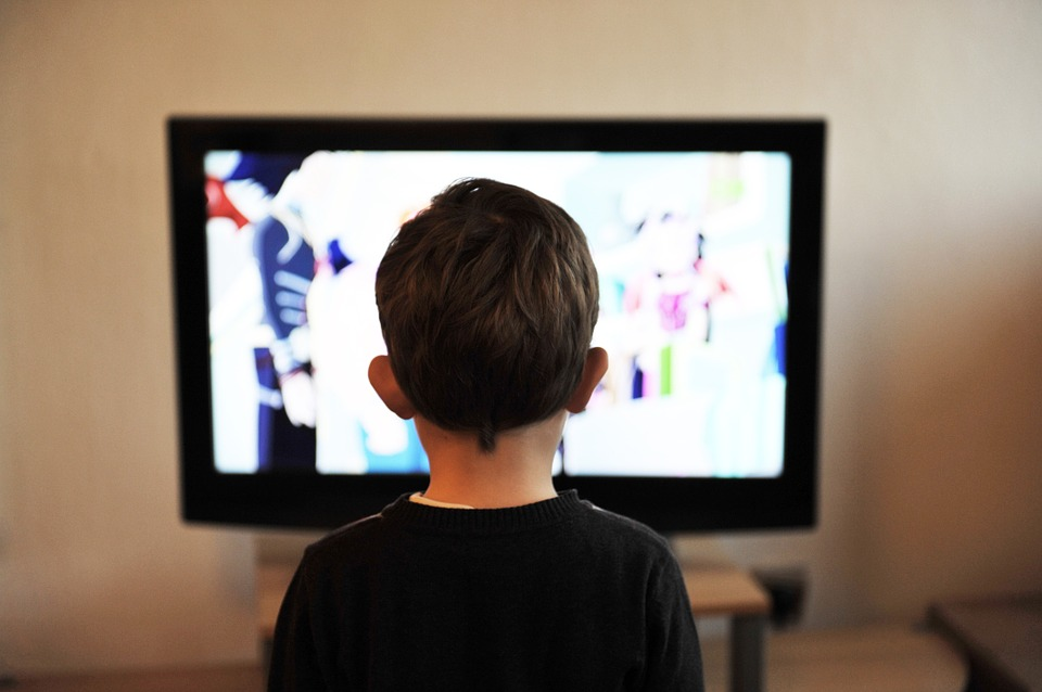Child watching TV.