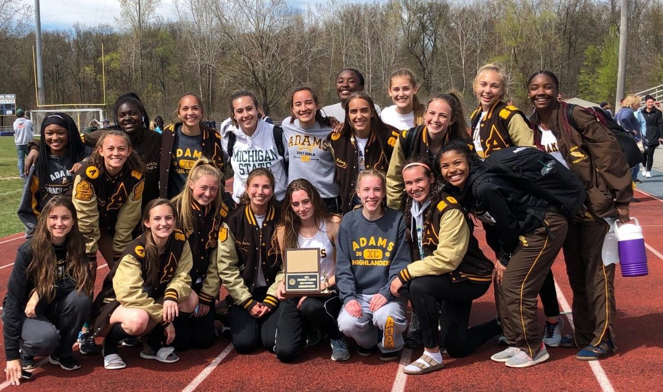 The girls team posing with their first place trophy.
