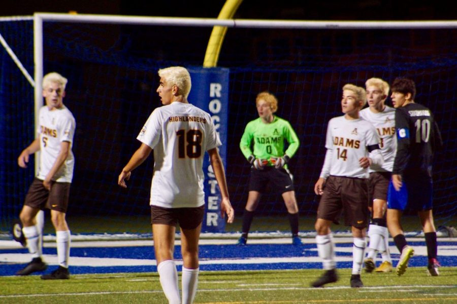 Rochester Adams Defenders and goalie shortly before a barrage of shots