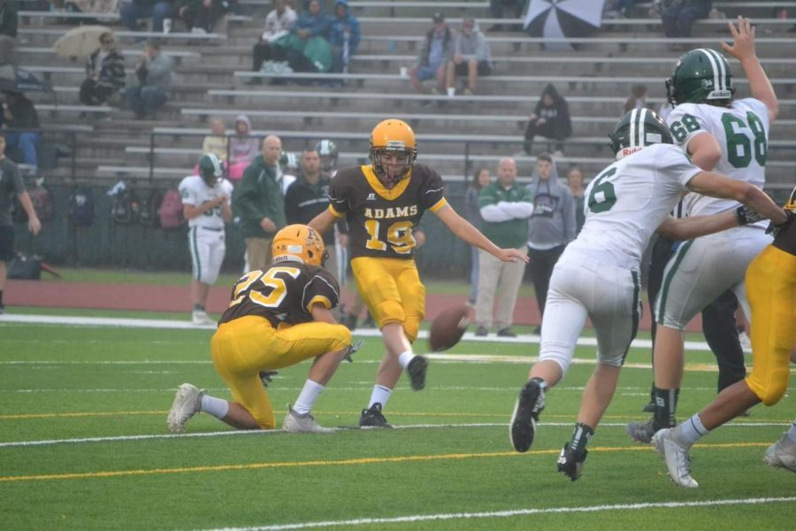 Tillotson kicking an extra point against the Lake Orion Dragons