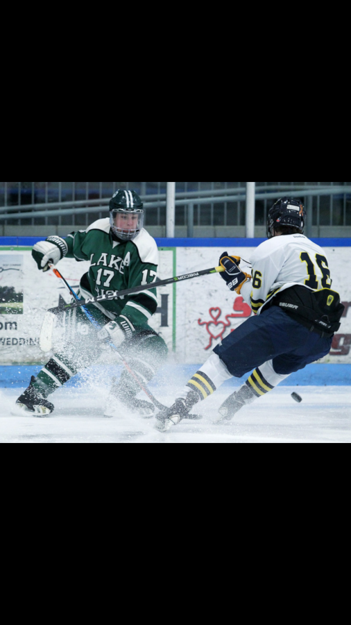 Caden Ebinger stopping the puck from getting in Rochester United's zone.