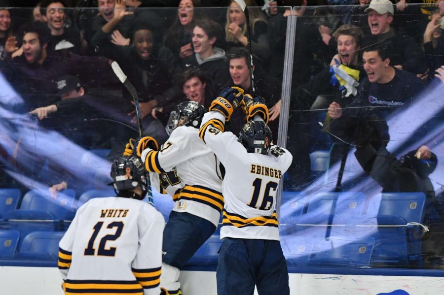 Caden Ebinger and Carter White celebrating with the fans after a great goal.