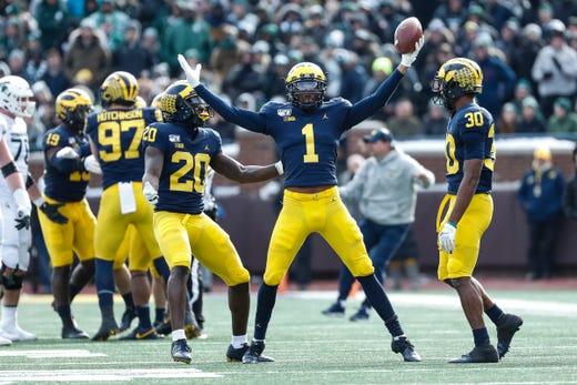Michigan defensive back Ambry Thomas (1) celebrates his interception against Michigan State during the second half at Michigan Stadium