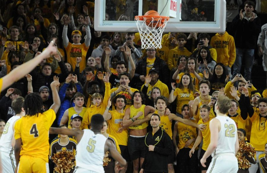 The highlander student section celebrating the winning free throw