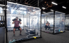 "Image of a gym located in california taking serious precautions towards the Coronavirus with isolating customers working out in their own ""pods""."