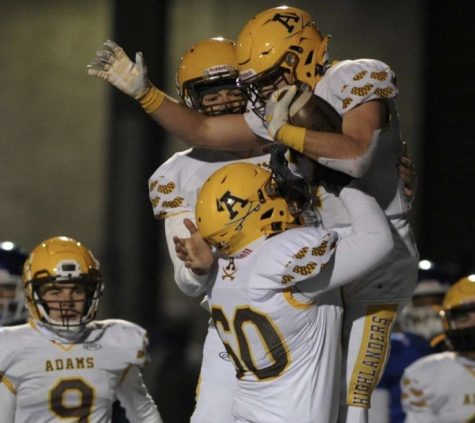 Senior Jack Stanley holding up senior Santino Orsini after a touchdown.