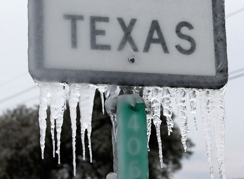 Long+icicles+hanging+from+Texas+street+sign.++